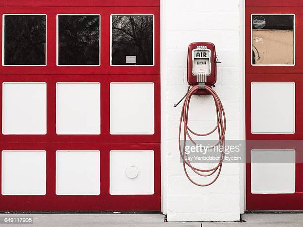 vintage air pump on wall at fuel pump - air pump stock photos and pictures