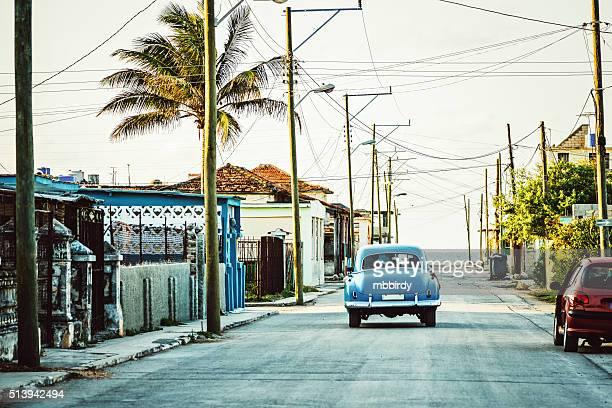 Vintage American car driving along street, Cuba