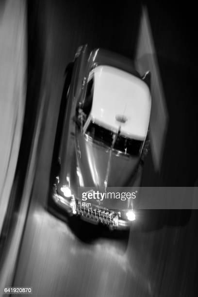 Vintage American Car Driving at Night, Havana, Cuba