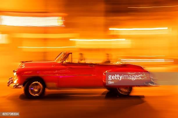 Vintage American car with tourists in Havana, Cuba