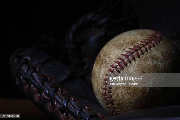 A vintage antique baseball glove and baseball mittt 7th June 2012 Photo Tim Clayton