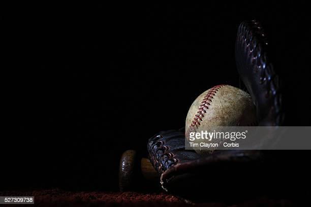 A vintage antique baseball glove used baseball and baseball bat 7th June 2012 Photo Tim Clayton