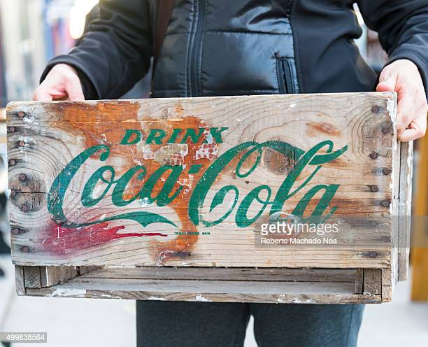 vintage antique Coca Cola crate Person holding old wooden crate labeled drink CocaCola in Toronto CocaCola is a carbonated soft drink It is produced...