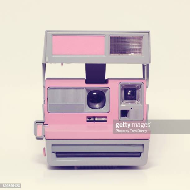 Vintage antique instant camera in pink