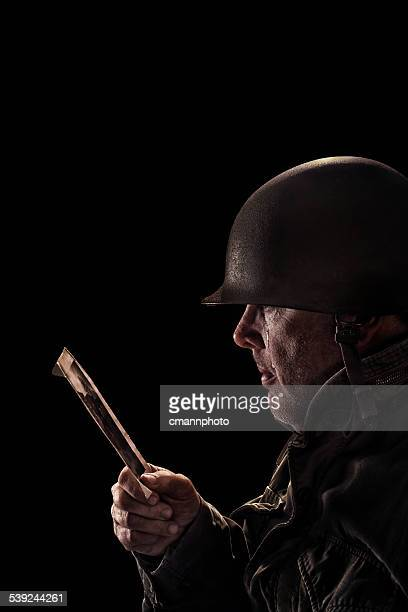 vintage army soldier tearing up looking at photo - cmannphoto stock pictures, royalty-free photos & images