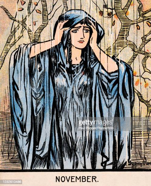 Vintage Art Nouveau postcard illustration featuring a long-haired young girl, representing November, wearing a blue-grey dress and cloak drenched in...