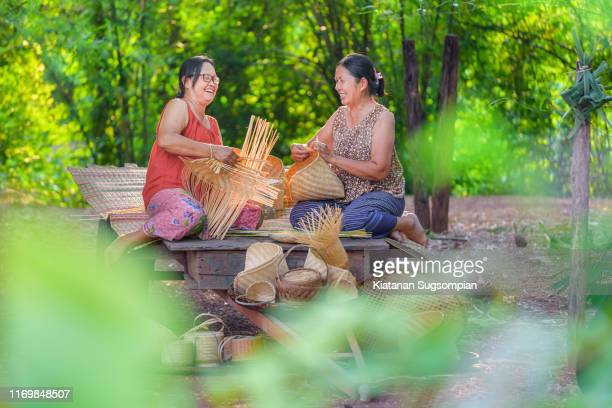 vintage asian bamboo basketry making - thai ethnicity stock pictures, royalty-free photos & images