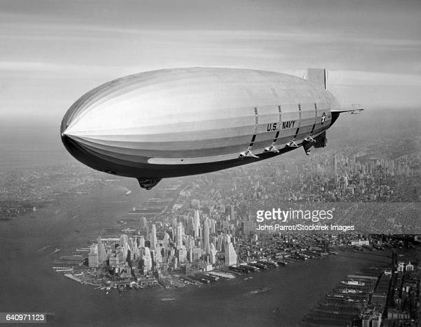 Vintage aviation photo of the USS Macon Airship flying over New York City, 1933.