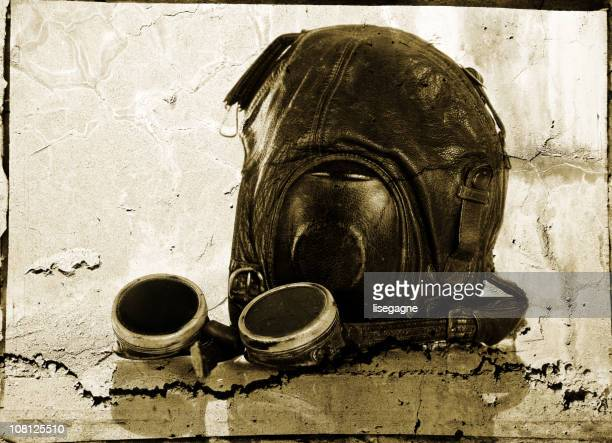vintage aviator hat and flying goggles, grunge effect - aviation hat stock photos and pictures