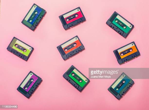 vintage background, with colorful cassette tapes - 1980 fotografías e imágenes de stock