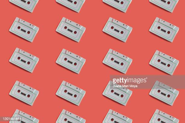 vintage background with white cassette tapes - pop music stock pictures, royalty-free photos & images