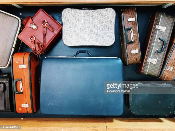 vintage bags and suitcases on conveyor belt in an airport - vacations stock pictures, royalty-free photos & images