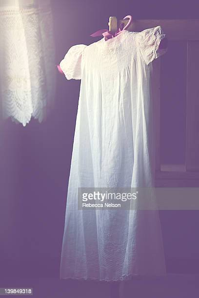 vintage baptismal gown by window light - christening gown stock pictures, royalty-free photos & images