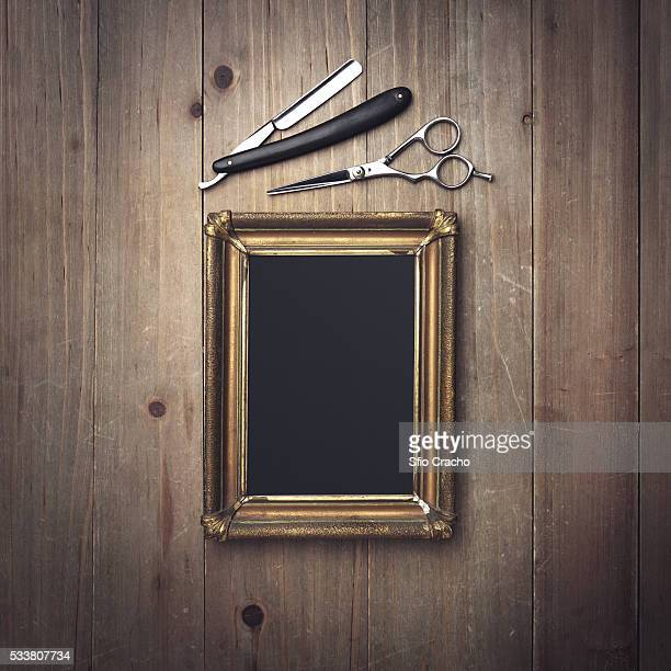 Vintage barber equipment and black canvas in a frame