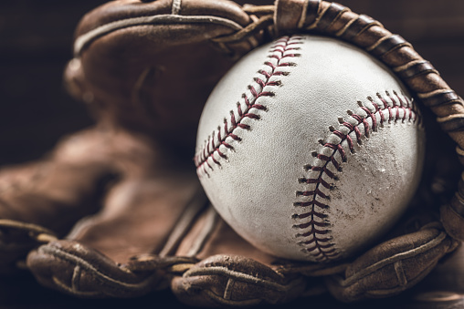 Vintage baseball gear on a wooden background 959733072