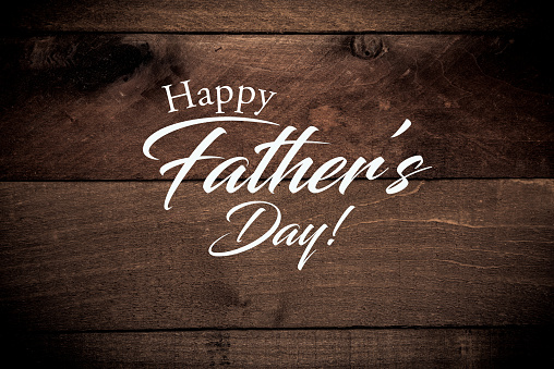 Vintage baseball gear on a wooden background with Father's day greeting 971815758