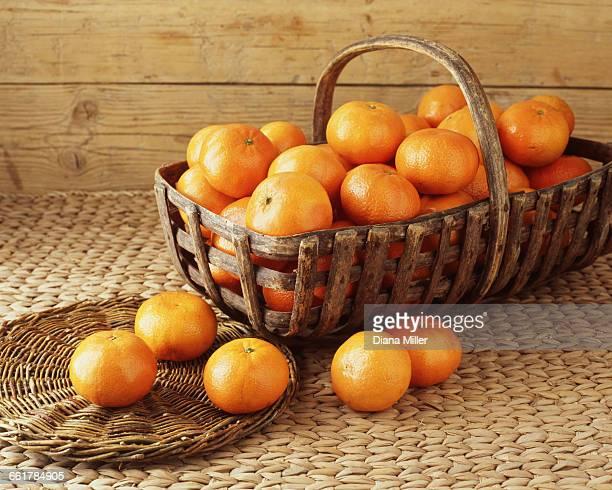 Vintage basket filled with tangerines