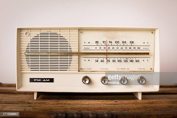 Vintage Beige Radio Sitting on Wood Table