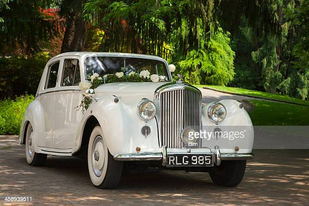 Vintage Bentley Wedding Car Decorated With Flowers in a Park