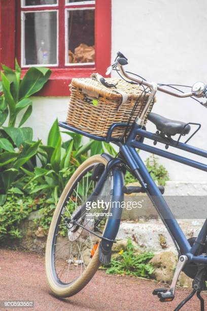 Vintage bicycle against a wall with a window