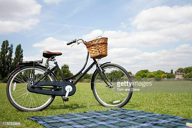 vintage bicycle in park with picnic basket - hamper stock pictures, royalty-free photos & images