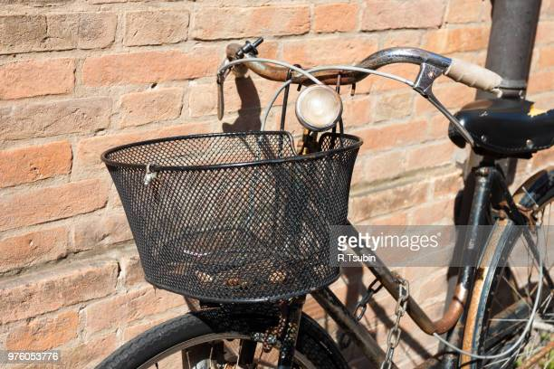 Vintage Bicycle Leaning against a Stone Wall - with basket