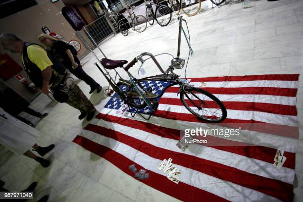 A vintage bicycle on a US flag seen at the 12th Athens Tattoo Convention 2018 A three day festival dedicated to tattoo art with tattoo artists from...