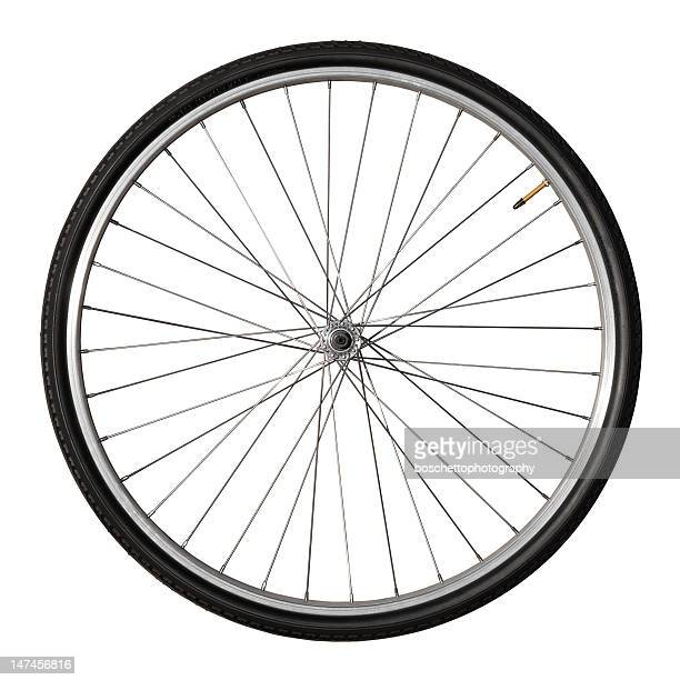 vintage bicycle wheel isolated on white - fietsen stockfoto's en -beelden