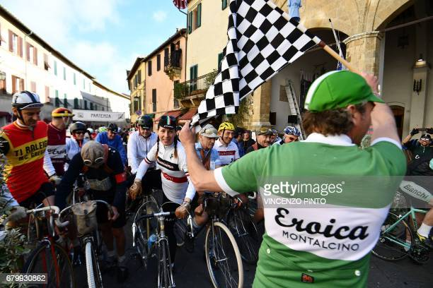 Vintage bicycle's enthusiasts take the start of the 'Eroica Montalcino' festive event on May 7 2017 near Montalcino L'Eroica Montalcino is a cycling...