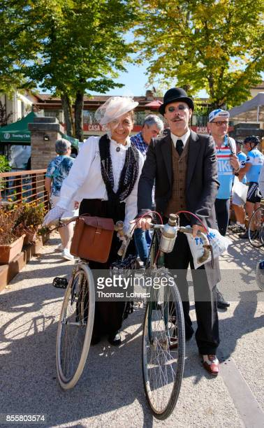 Vintage bicylcles enthusiasts Nadia Montironi of Belgium and Stefano Franceschini of Italy stand with their historic bikes during the 21st edition of...