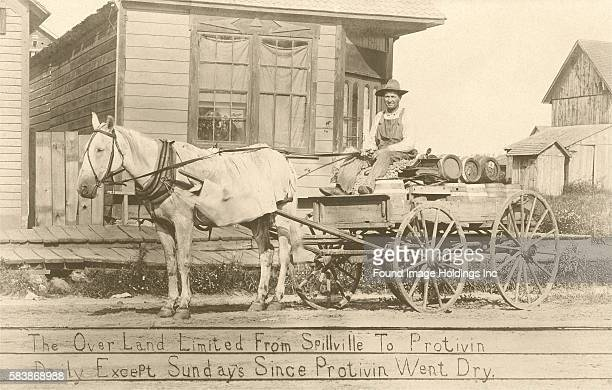 Vintage black and white photograph of a bootlegger on his horse-rrawn cart, 'The Over Land Limited From Spillville To Protivin Daily Except Sundays...