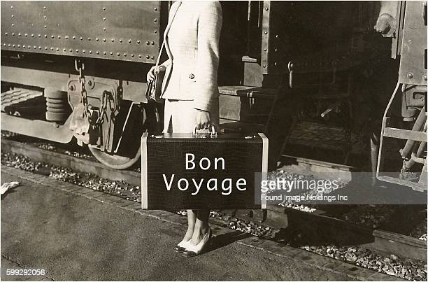 Forties Lady Standing by Train Bon Voyage