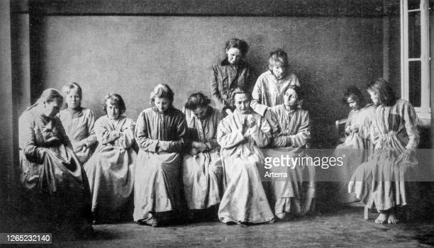 Vintage black and white photograph showing group of schizophrenic women suffering from the mental illness schizophrenia.