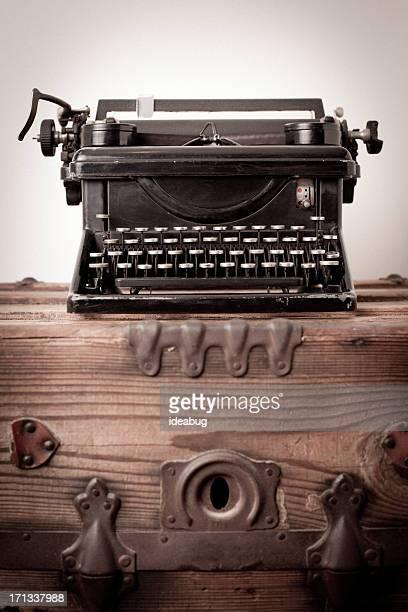Vintage Black, Manual Typewriter, Sitting on Wood Trunk