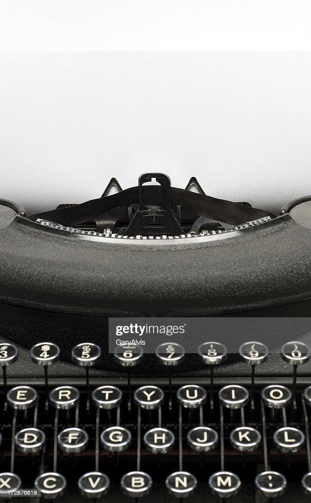 Vintage black typewriter w/paper for text : Stock Photo