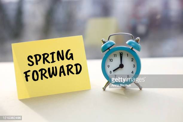 vintage blue alarm clock. daylight saving time symbol. - daylight saving time stock pictures, royalty-free photos & images