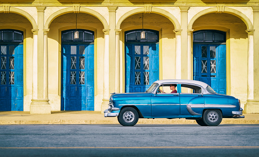 Vintage blue oldtimer car driving through Old Havana Cuba - gettyimageskorea