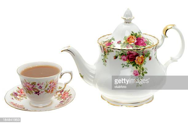 vintage bone china teapot with a cup of tea. - saucer stock pictures, royalty-free photos & images