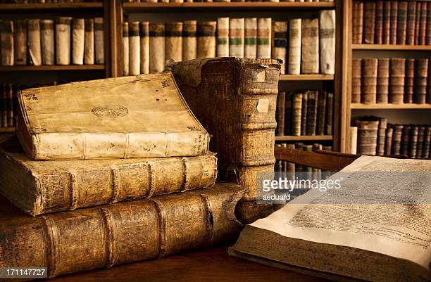 vintage books in a library - ancient stock pictures, royalty-free photos & images