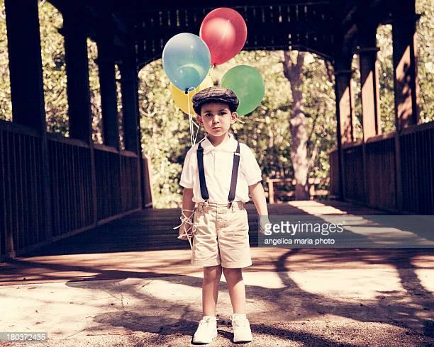 Vintage boy with birthday balloons