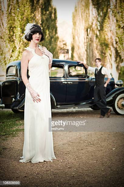 Vintage Bride and Groom with Antique Automobile