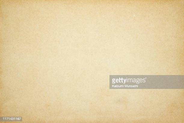 vintage brown paper background - old paper stock pictures, royalty-free photos & images