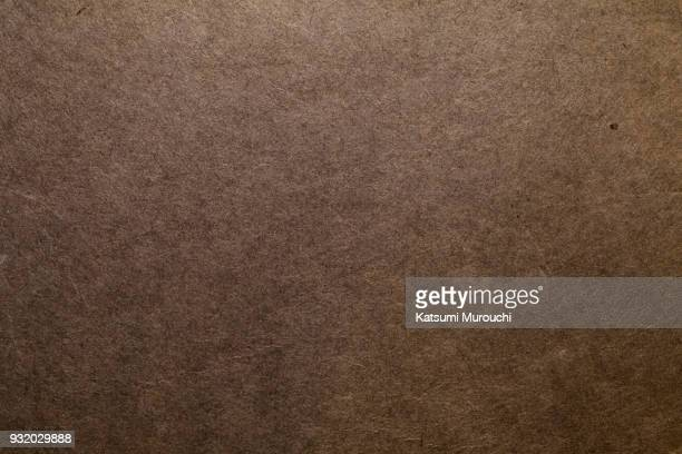 vintage brown paper texture background - braun stock-fotos und bilder
