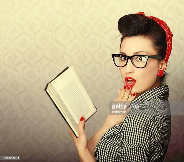 Vintage brunette reading a book