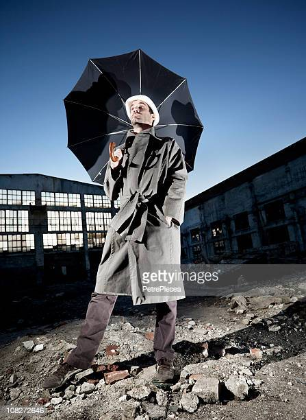 Vintage businessman with an umbrella