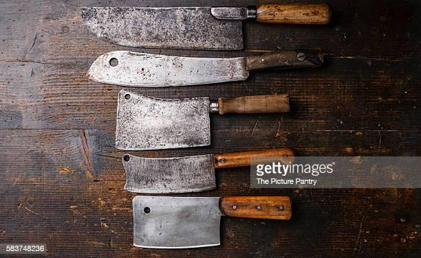 Vintage Butcher meat cleavers on dark wooden background