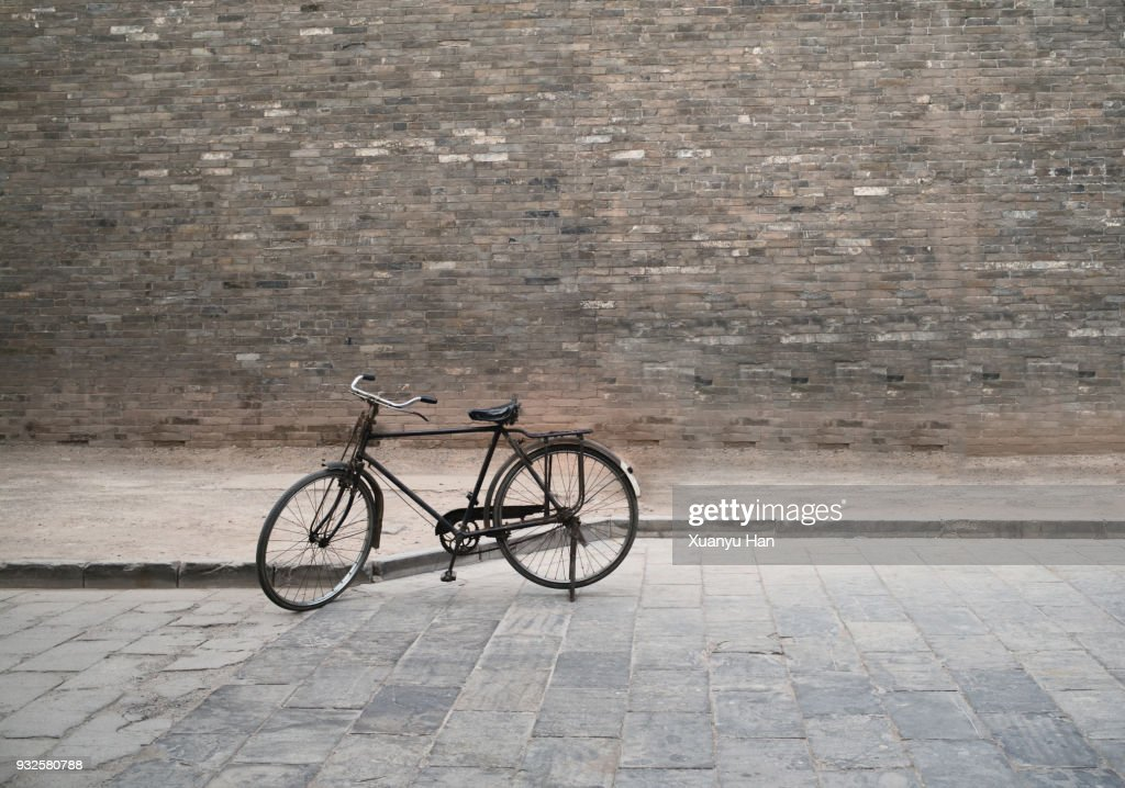 Vintage Bycicle and brick wall : Stock Photo