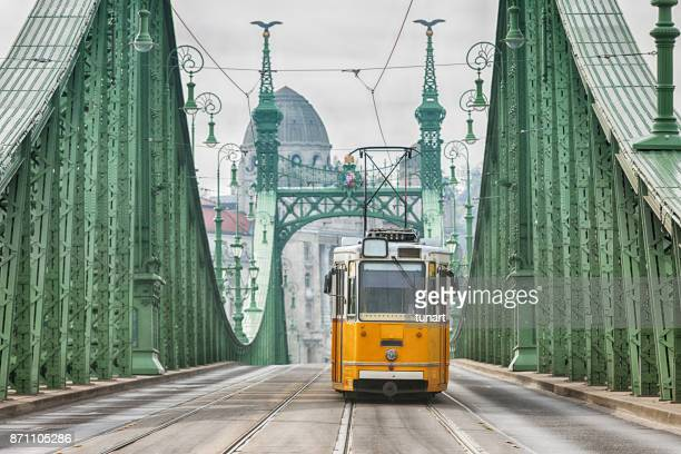 vintage cable car on liberty bridge - budapest stock pictures, royalty-free photos & images