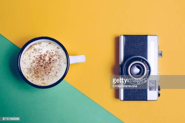 Vintage camera and mug of coffee