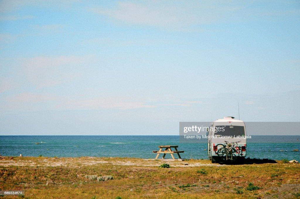 Vintage Campervan on a Beach : Stock Photo